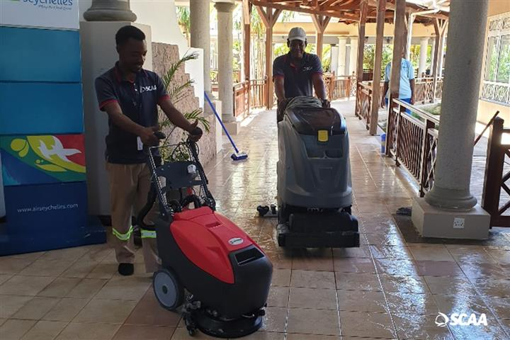 Praslin airport staff focusing on cleaning of the interior